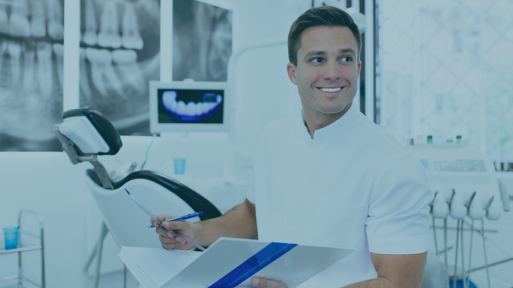 dentist looking through marketing strategies for his practice